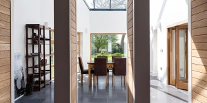 Skylit open plan dining area. Bespoke oak doors fit flush into pillars.