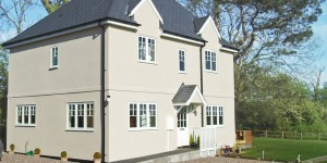 Alternative view of three bedroom cottage, featuring polymer render.
